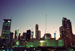 Just a Rooftop View (thomas_anthony__) Tags: canon canona1 a1 film 35mm analog kodak kodakgold200 gold 200 light bokeh dof gradient sky sunset dusk lights city citylights green blue orange melbourne australia oz cranes crane construction roof rooftop buildings building skyline adventure vintage grain travel explore
