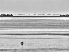 passing by... (kurtwolf303) Tags: wattenmeer fhr germany sea ocean halligen persons people water wasser tideland schleswigholstein monochrome bw sw outdoor windturbines olympusem1 omd microfourthirds micro43 systemcamera meer topf25 250v10f 500v20f topf50 topf75 750views 900views 1000v40f 1500v60f topf100 topf150 2000views