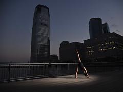 Skyline Stretch (Narratography by APJ) Tags: apj dance narratography nj skyline bluehour dusk skyscraper stretch dancer