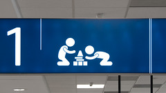 Every Knee Shall Bow to Me (Goran Patlejch) Tags: pictogram blue children kids playing kidscorner airport terminal prague praga praha prag goenetix gntx patlejch patlejh prayer blocks game building pray praying kneeling bowing religion church temple