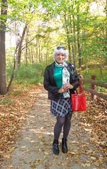 Sundays In The Park With Laurette (Laurette Victoria) Tags: autumn leaves color milwaukee jacobuspark laurette woman jacket mini skirt purse silver tights scarf