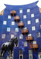 Jacob (Douguerreotype) Tags: uk gb britain british england london city urban architecture buildings purple windows balconies balcony diagonal horse dray statue southwark circle