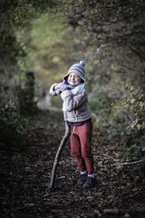 Emma with stick (Boxertrixter) Tags: lincolnshire woodland fujifilm fujixpro2 child daughter fun fujixf90mmf2wr autumn classicchrome