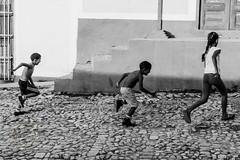 Streets of Trinidad (Simone Della Fornace) Tags: cuba trinidad street streetphotography kids playing running blackandwhite black white bianco nero biancoenero bw bn sony a7rii