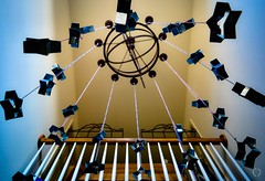 Cookie Cutter Star Shower (Little Hand Images) Tags: star starshape cookiecutters starshower astrolabe foyer highceiling christmas railing balcony