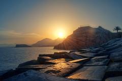 DSC_7500 - Sunset at the breakwater (pucherico) Tags: sunset sun brick water stone landscape nikon fav50 hdr breakwater fav10 fav25 fav75