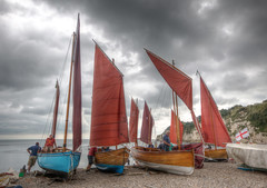 Lugger Fleet (Raphooey) Tags: uk sea england cliff fish southwest west beach water beer clouds race canon boats eos boat seaside fishing sailing south shingle shoreline sailors pebbles racing cliffs devon gb sail mast sailor hull fleet masts seashore hdr seaton seawater lugger photomatix 70d mizzen lugsail luggers riggingcloud