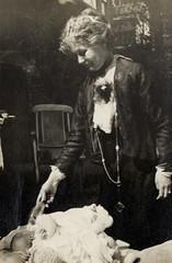 Emmeline Pankhurst feeding a baby, 1915.