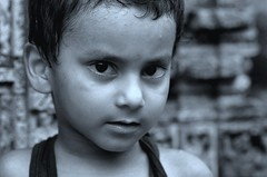 Portraits from Rural Bengal (pallab seth) Tags: boy portrait blackandwhite india monochrome face children happy kid eyes nikon village child outdoor expression expressive youngster bengal d7000 tamronaf90mmf28dispam11macrolens