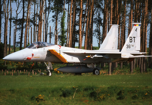 """F-15c 84-0009/BT 36thFW based at Bitburg AFB, Germany. The """"Boss bird"""" is seen at rest in the woods at the back of Bentwaters. 16/05/92"""