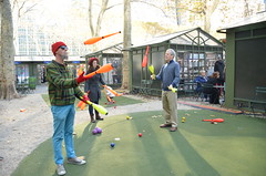 Jugglers (thoth1618) Tags: park christmas nyc newyorkcity red orange ny newyork yellow december manhattan pins plastic bowling juggling juggler bowlingpins bryantpark jugglers photooftheday 2015