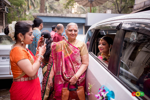 The pretty cousin takes photo of the bride just before she leaves