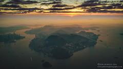 Hong Kong sunrise (Jon Bowles) Tags: hongkong aerial color landscape city sunrise sea island hongkongisland sky morning outdoor inversion temperature haze china flight aerialphotography