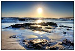 Rocks and Waves (juliewilliams11) Tags: beach landscape shore photoborder sea seaside ocean water coast sunset outdoor sand serene sky rock cloud newsouthwales australia blue cokin filter gnd light