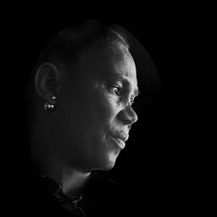 Woman with Earring (Carolbreeze99) Tags: portugal street people portrait lowkey lighting face character bw candid closeup beauty thought pensive
