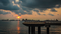 Sunrise by the bay (elenaleong) Tags: marinabarrage seaside sunrise elenaleong darkclouds