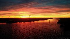 Nation wide sunset (Johan Konz) Tags: countrywide sunset polder ilpendam waterland netherlands outdoor wartercourse water grass field red orange sky nikon d90 landscape serene athmosphere boat windmill creek dorreilp