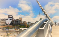Temporal Crossings (Dom Guillochon) Tags: california road bridge usa architecture modern downtown sandiego time traintracks pedestrian billboard advert rails once suspended temporal crossings centrallibrary harbordrive petcopark