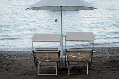 Ionian Sea Waiting (CarusoPhoto) Tags: trip sea vacation italy beach john evening twilight chairs pentax poetic sicily lonely caruso taormina ks2 ionian carusophoto