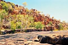 Rocky river bottom and sculptured escarpment at Barnett River Gorge, Kimberley 1996 (SubiYurek) Tags: 1996 barnettrivergorge escarpment gibbriverroad kellie kimberley kupungarri lex maryjolob mtbarnettstation rockart