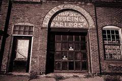 Farriers (Pete Zarria) Tags: southdakota horseshoeing ghost sign red brick mono