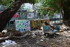 Saen Saeb - Phayathai, Bangkok (jcbkk1956) Tags: phayathai rubbish chair bench seat 1855mmf3556 d3300 nikkor nikon colour graffiti khlongside saensaeb thailand bangkok trees worldtrekker decay ratchathewi