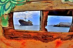 Eye Eye Ship Ahoy (tcees) Tags: telamon lascaletas lanzarote sea shipwreck clouds sky rowingboat graffiti outdoor canaries canaryislands templehall