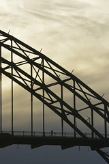 Jogging over the Yaquina bridge (Lostinplace) Tags: people bridge running jogging outside sillouette white clouds