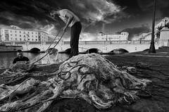 at work (Marco Brunetti) Tags: ortigia syracuse sicily fisherman street pentaxk30