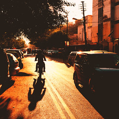 Silhouette shadow rider (Fortunes2011. trying street photography) Tags: silhouette shadow sunset sunlight street motorcycle tree golden