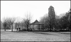 A Walk In The Park. (curly42) Tags: park gardens walking people gloucesterpark gloucester winter pavillion bandstand