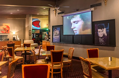Television plays Elvis concerts at the Heartbreak Hotel on Elvis Presley Boulevard in Memphis Tennessee. (CarmenSisson) Tags: usa restaurant hotel cafe memphis tennessee lodging diner tables presley graceland touristattraction jungleroom elvispresley heartbreakhotel