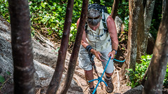 2015 - Sea to Sky Hike - 9 of 19 (Ted's photos - For Me & You) Tags: people girl sunglasses nikon rocks bc hiking rope backpack cropped hiker wristwatch vignetting steep walkingpoles tedmcgrath tedsphotos peopleandpaths seatosummittrail