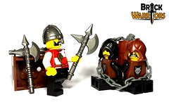 Tell me where he is! (BrickWarriors - Ryan) Tags: castle lego captured battle medieval fantasy axe hood rogue custom nasal helm minifigure brickwarriors