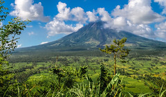 Mayon Volcano (FotoGrazio) Tags: freetodownload composition nature photographersinsandiego fotograzio digitalphotography capture waynegrazio scenic photographicart photographersincalifornia mayonvolcano freeimage landscape waynesgrazio freepicture photoshoot albay philippines flickr clouds sandiegophotographer downloadforfree worldphotographer californiaphotographer artofphotography beautiful greenandblue farmland bicol 500px legazpi explore volcano internationalphotographers photography mountain