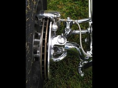 Disc brake (Brave Heart) Tags: lookdown lookingdown carshow car hotrod reflection shock grass tire chrome chromed streetrod brake discbrake