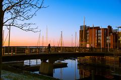 Walking across the bridge (Maria Eklind) Tags: cityview city twilight skymmning buildings malm boats street reflection spegling sweden streetview vstrahamnen bridge dusk skneln sverige se