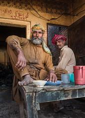 A corner in a small restaurant (Sohail Karmani) Tags: sahiwal montgomery portrait punjab pakistan punjabi pakistani leicaq street streetphotography streetportrait beardedmen lunch 28mm summilux