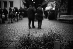 They go (stefankamert) Tags: stefankamert street dof bokeh bw baw monochrome noir noiretblanc blackandwhite blackwhite black white schwarzweis sony a7 sonya7 ilce7 voigtländer nokton classic 35mm fullframe mirrorless alienskin exposure blurred people blur