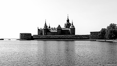 The legendary Kalmar castle (Pawe Szczepaski) Tags: old blue sea sky reflection building tree tower castle heritage history tourism reed water stone wall architecture se design ancient europe exterior view sweden fort outdoor famous culture royal style landmark swedish baltic medieval historic kings greenery nordic fortification scandinavia fortress defense turret renaissance vasa kalmar slott kalmarln