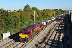66089 seen at South Moreton working the 6X44 Dagenham to Didcot 'Ford motors train' on 10-9-15. Copyright Ian Cuthbertson (I C railway photo's) Tags: ford train shed railway class66 ews southmoreton 6x44