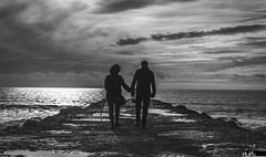 Strolling near the sea (Nuno M.S. Martins) Tags: sea travel bw seascape cluds sky people costacaparica
