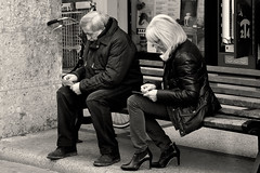 in scratchies we trust (Stefano E) Tags: street people blackandwhite woman man bench strada italia gente candid sunday streetphotography sundaymorning scratchandwin panchina allaperto candidstreet grattaevinci sundaymorningonthebench