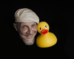 """Rubber Ducky, I'm Awfully Fond of You!"" (Oliver Leveritt) Tags: nikond610 afsnikkor2470mmf28ged oliverleverittphotography su800 su800wirelessspeedlightcommander cls nikoncls creativelightingsystem offcameraflash sb600 umbrella blackbackground selfie selfportrait man beret duck rubberduck rubberducky rubber ducky portrait goatee smile yellow"
