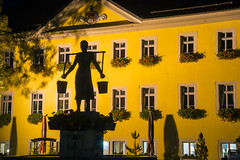Water of life carried high (OR_U) Tags: 2016 oru germany lowersaxony schningen marketplace watercarrier watermaid silhouette jethrotull cityhall yellow night shadows