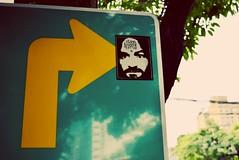 Chaz (Studio Tattoo Bangkok) (jcbkk1956) Tags: mad stare eyes chaz charles manson bangkok street sign green yellow sticker tattoo nikon d3300 nikkor 1855mmf3556dx arrow charlie reflection