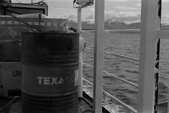 Texaco (AnniversaryRoad) Tags: 135 35mm 400 50mm bw delta delta400 europe ft2 iceland ilford ilforddelta nikkormat nikon nipponkogaku stykkisholmur texaco analog barrel black blackandwhite boat clouds day ferry ferryride film monochrome oil oilbarrel outdoor outside ship transport water white