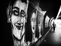 faces (Sandy...J) Tags: olympus monochrom fotografie mono noir sonnenlicht women germany gehen gegenlicht grafitti gesicht frau face photography passage atmosphere atmosphre alone allein blackwhite bw black bavarian bayern backlight city deutschland darkness dark dunkelheit durchgang einfarbig light shadow white licht urban unterfhrung underpass sunlight tunnel walk walking wall wand street streetphotography sw schwarzweis strasenfotografie stadt wandmalerei