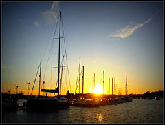 Bembridge Harbour sunset (Jason 87030) Tags: bembridge harvour sun sunset sky clouds clera water boats yachts masts ligting refelction island holiday iow isleofwight october 2016 blue orange rays sea border frame effect uk england silhouette