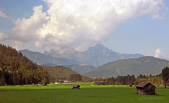 Austrian landscape (Vee living life to the full) Tags: italy leger travel touring holiday nikond300 heathaze view road sky cloud blue water light evening sunset sunrays sunburst lowlight highlight people travelling sun mountain landscape rock towers austria